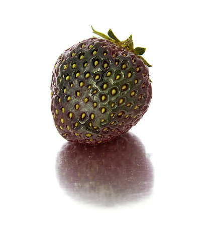 beautiful, ripe, large bright strawberry on the isolated background. Isolate green Strawberry. bright red berry Banco de Imagens