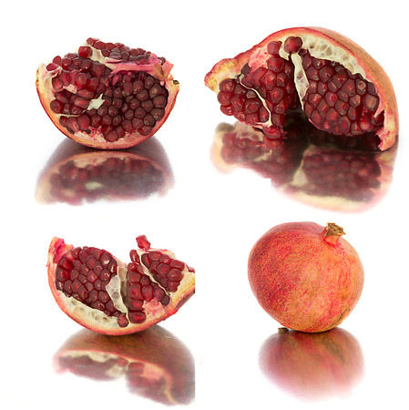 a lot of different garnets. beautiful, juicy, ripe pomegranate on white background, juicy and bright Garnet without background, isolate