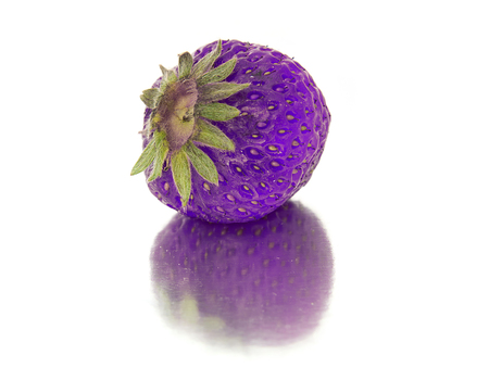 beautiful, ripe, large bright strawberry on the isolated background. Isolate lilac, purple Strawberry. bright red berry