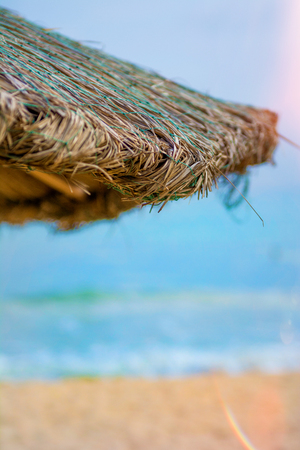 Beach beautiful thatched umbrellas and bright turquoise sea, great recreation and relaxation. tropical paradise. hot countries