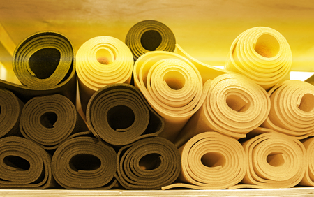 materials for yoga classes, mats, bricks and straps, bowl for meditation. everything you need for yoga. spiritual practice.