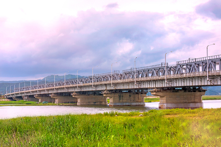 The railway bridge over the river to navigate by car and train. Russian Railways