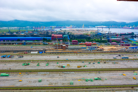 top view of the port, many different cocks and overloading of coal, a large seaport. Trucking.