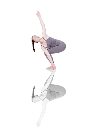 young girl performs different poses of yoga, flexible beautiful model on a white background. meditation and asanas. the harmony of body and spirit Stock Photo