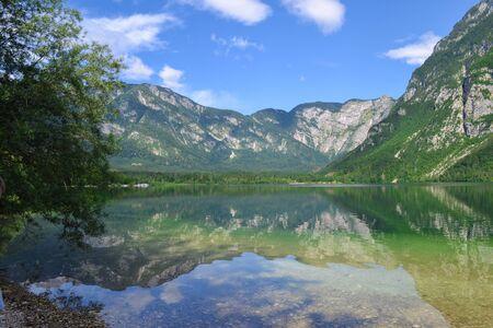 Mountain lake Bohinj. Slovenia, Julian alps, Triglav national park. Scenic view to lake and rock
