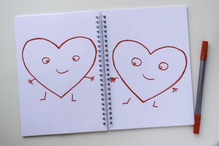 Drawn by a red felt-tip pen on a white sheet in a notebook. Happy hearts with arms, legs and eyes.