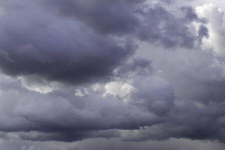 Grey cumulus clouds on blue sky before rain.