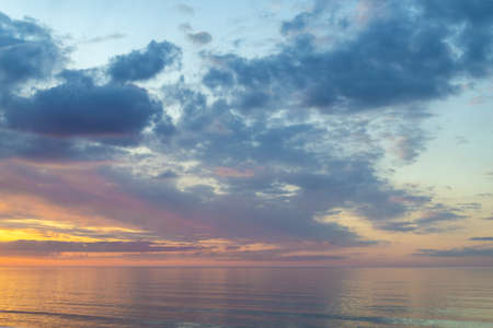 Summer mood. Beautiful colorful sunset over Baltic sea in Jurmala resort, Latvia. Warm evening on beach. Scenery view. Banque d'images