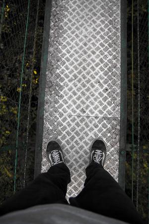 Foot on the bridge for adventure Stock Photo