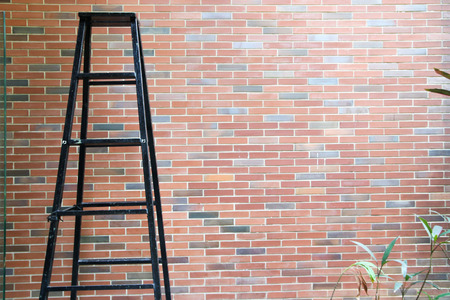 Stairs on brick wall