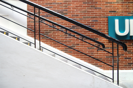 Stairs with brick wall