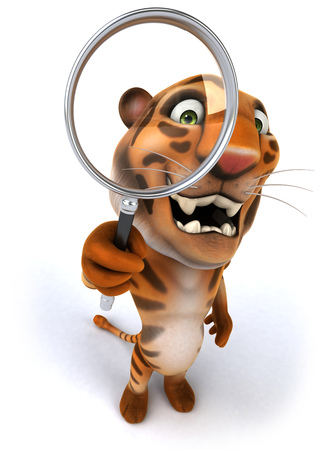 Happy tiger holding up a magnifying glass Stock Photo