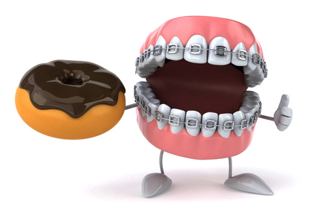 fried: Dentures character with braces holding a donut Stock Photo