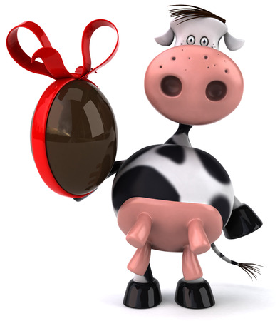 udders: Cow character holding a chocolate egg Stock Photo