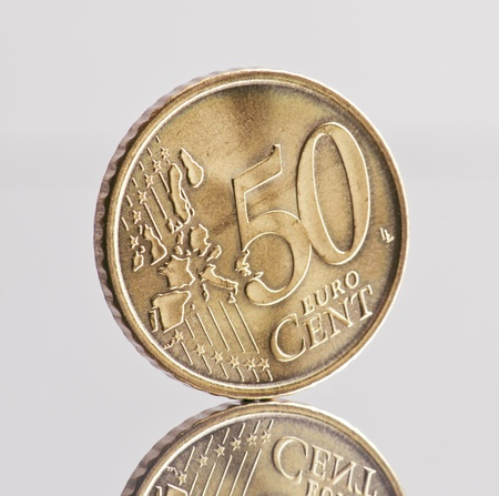 coin 50 euro cents, reflected in the base Stock Photo - 12048944