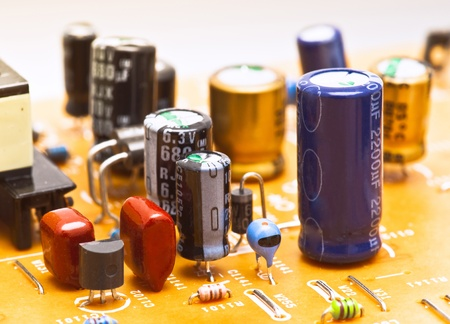 capacitors and electronic components mounted on a motherboard photo