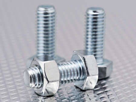 nuts and bolts bright group, randomly arranged bright metal background Stock Photo - 12802395