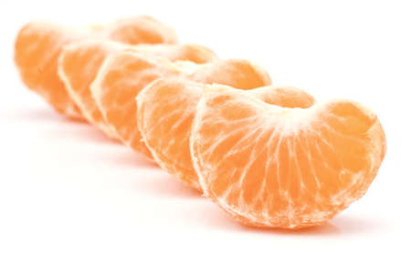 mandarin orange segments arranged in white base Stock Photo