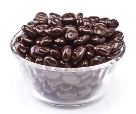 bowl of chocolate covered raisins, isolated on white Stock Photo - 12802446