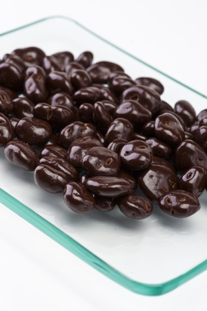 chocolate-covered raisins on transparent tray Stock Photo - 12802453