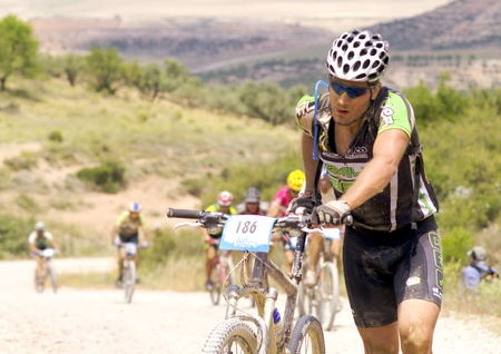 mountainbike: BARDENAS REALES, NAVARRA, SPAIN- JUNE 28  mountain-bike cyclists during a race through the nature reserve The Bardenas. on June 28, 2008, in Tudela, Navarra, Spain Editorial