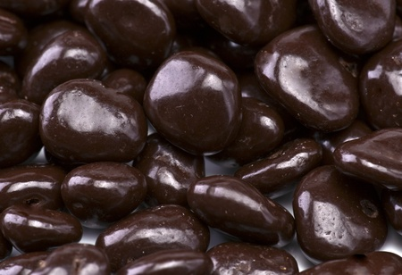 Chocolate covered raisins, making approach Stock Photo - 13025604