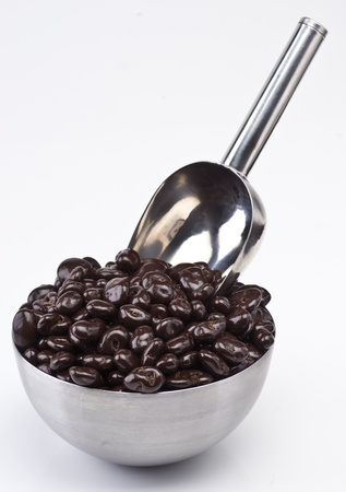 raisins with chocolate in metal bowl with ladle Stock Photo - 13025600