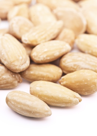 Natural almonds, peeled, over white background Stock Photo
