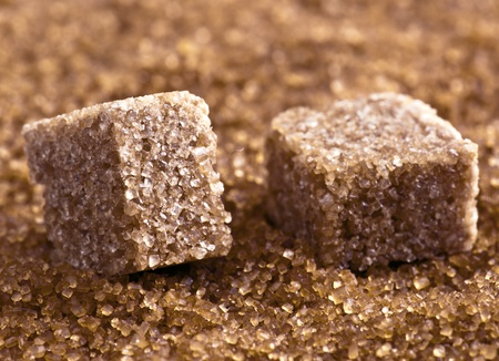 brown sugar cubes on powdered sugar photo