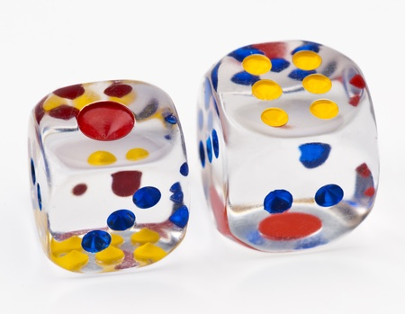 transparent acrylic dice white with colored dots on white base Stock Photo - 13115605