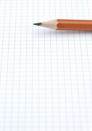 group of pencils on blue line grid sheet Stock Photo
