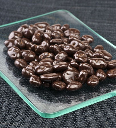 chocolate-covered raisins on transparent tray Stock Photo - 13245457