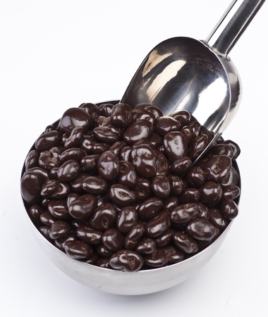 covered: raisins with chocolate in metal bowl with ladle