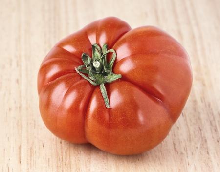 tomato variety  Tudela ugly  on wood base