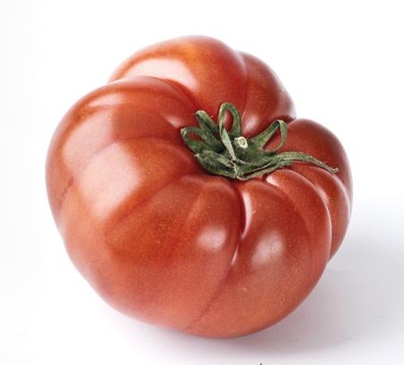 tomato variety  Ugly Tudela,  in white base Stock Photo
