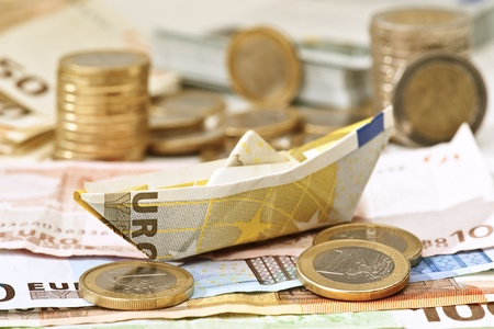 euro boat, sailing in the sea of money Stock Photo