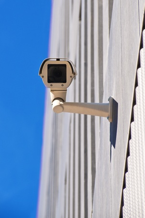 surveillance camera on the wall of a public building Stock Photo - 13504263
