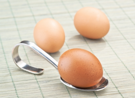 pooled: pooled egg and spoon, deposited on a rough
