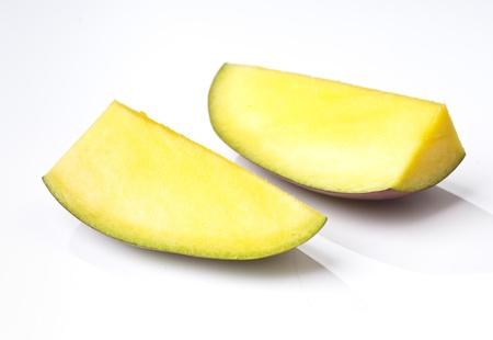 sectioned: sectioned Mango isolated on white base Stock Photo