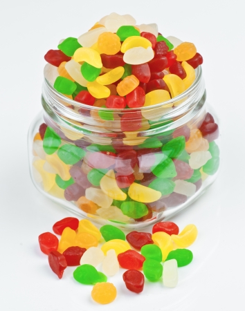 fruit jellies in clear glass jar photo