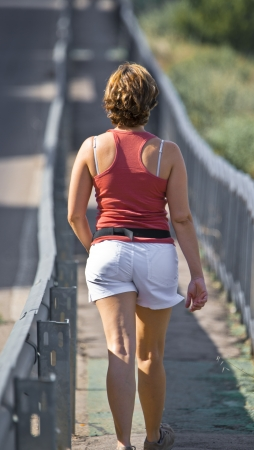 TUDELA - JUNE 07: unknown woman walking in her spare time to keep fit,  On june 07, 2012 in Tudela, Spain