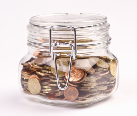 preserves jar filled with coins saved photo