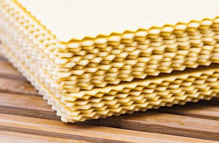 raw lasagna pasta, ready to be cooked on wooden slats base photo