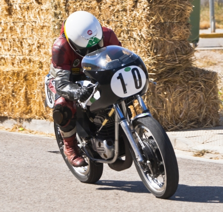 CINTRUENIGO - JUNE 16: unidentified riders involved in a fierce competition of classic motorbikes. On June 16, 2012 in Cintruenigo, Navarre, Spain