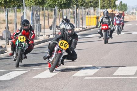 fierce competition: CINTRUENIGO - JUNE 16: unidentified riders involved in a fierce competition of classic motorbikes. On June 16, 2012 in Cintruenigo, Navarre, Spain