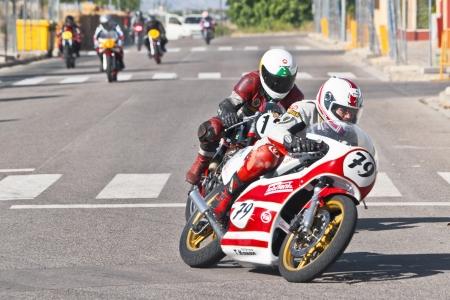 CINTRUENIGO - JUNE 16: unidentified riders involved in a fierce competition of classic motorbikes. On June 16, 2012 in Cintruenigo, Navarre, Spain Stock Photo - 14145977