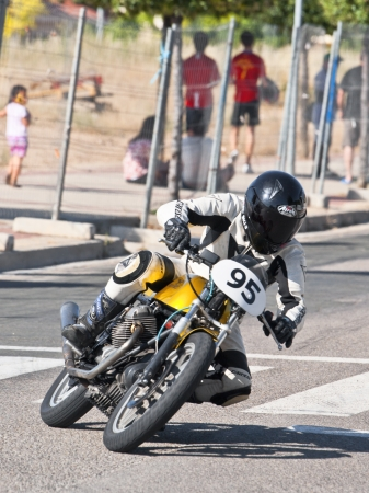 CINTRUENIGO - JUNE 16: unidentified riders involved in a fierce competition of classic motorbikes. On June 16, 2012 in Cintruenigo, Navarre, Spain Stock Photo - 14145974