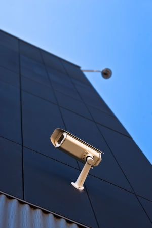 surveillance camera on the wall of a public building photo