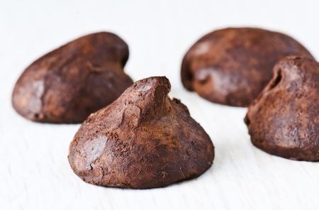 truffled chocolate drops on mottled white base Stock Photo - 14235976