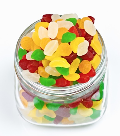 fruit jellies in clear glass jar photo